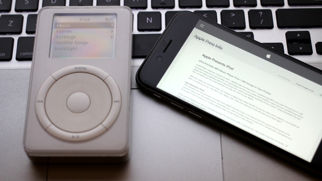 The original click wheel iPod, next to an iPhone 6.