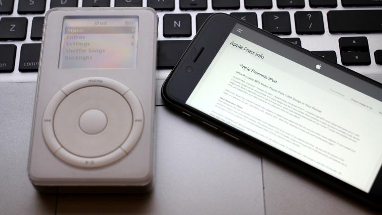 The original click wheel iPod, next to an iPhone 6.